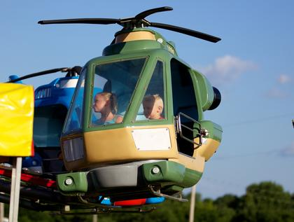 Andie and Carter Durbin take a rise in a helicopter ride at the Nelson County Fair Monday.
