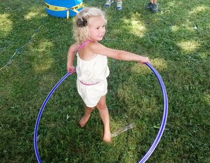 Audrina Moore, daughter of Matt and Katrina Moore, shows off the hula hoop she won at the Howardstown Picnic.