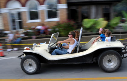 A dune-buggy drives in Main Street in New Haven, shortly before the Rolling Fork Iron Horse Parade begins Saturday.