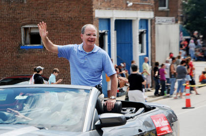Congressman Brett Guthrie rides in a car at the Rolling Fork Iron Horse Festival in New Haven Saturday.