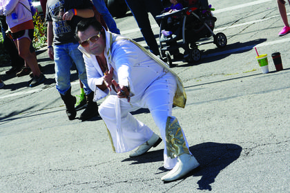 An Elvis impersonator poses during the parade at the Rolling Fork Iron Horse Festival in New Haven Saturday.