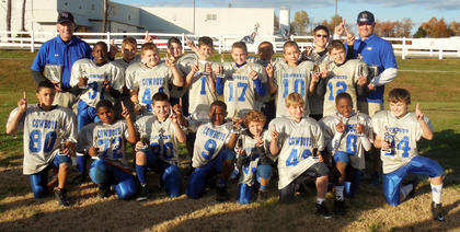 The Cowboys were champs of the Bardstown-Nelson County Youth Football League's Junior Division with a 40-8 win over the Bengals.