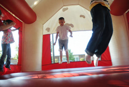 Mackenzie Patton, Kaleb Mudd and Garrett Newton jump in a bounce house at Kid's Day Thursday. Kid's Day is sponsored by the Bardstown Rotary Club.