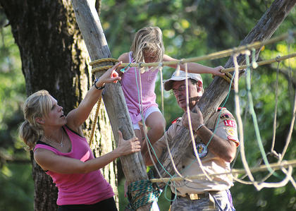 Brooke King, Bardstown, helps her daughter, Carlie King, 4, cross a rope bridge that was set up by Bob Bruno and Boy Scouts 142, United Methodist Church. Kids' Day was sponsored by the Bardstown Rotary Club.