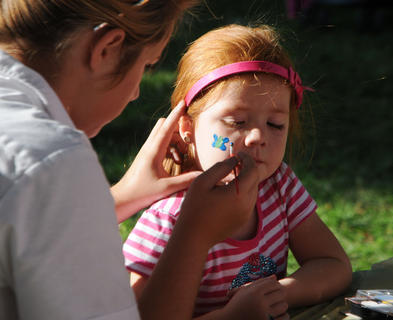 Calista Miller, 4, Bardstown, gets a butterfly painted on her face at Kids' Day last week.