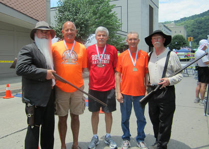 Bardstown members of the Kentucky Hill Runners Club recently completed the 26.2 mile Hatfield and McCoy Marathon in Williamson, W. Va. June 9. Pictured are actor Jerry Akers dressed as William Anderson Hatfield, runners Tony Hall, Steve Hagan and Tim Loudermilk and actor Doyle Van Meter dressed as Randall McCoy.