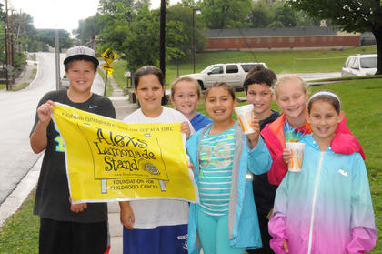 Mrs. Garrett's fourth-grade class recently raised $700 for childhood cancer research with their Alex's Lemonade Stand on Saturday, May 10.   Pictured from left to right are:  Carter Zutterman, Lydia Goode, Sara Spalding, Teonna Morgan, Ian Downey, Madeline Meredith and Chloe Nicholson.