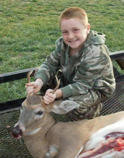 Logan Cross, 9, son of Allen and Jeri Cross, got his first deer  a 5-pointer  while hunting with his dad.