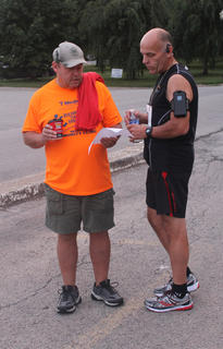 Martin McDonald of Springfield and Scott Broell of Boston talk before the Nelson County Community Clinic 5K run Saturday.