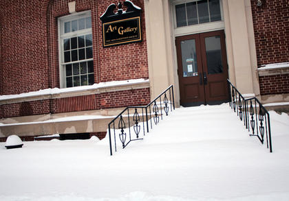Several inches of snow left the steps to the art gallery on the Square encased.