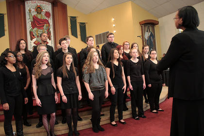 "Students with Bardstown High School's chorus sing ""The Star-Spangled Banner"" at Monday's Martin Luther King Jr. Day celebration at St. Monica Catholic Church."