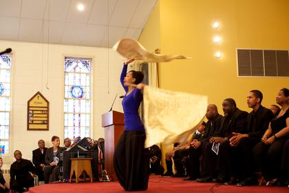 Tiffany Brock performs a liturgical dance at St. Monica during Monday's Martin Luther King Jr. Celebration.