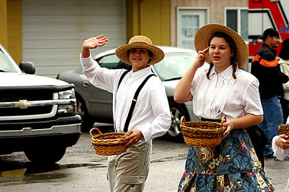 Morgan Patton and Clara Pozgay participate in the parade Saturday. The pair demonstrated children's games and taught other kids games from early 1900s.