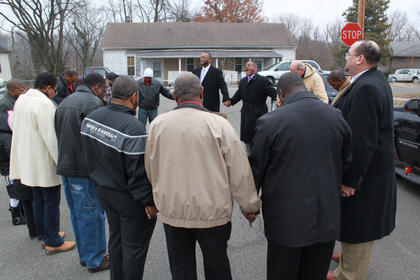 Pastor Michael Smith of First Baptist Church of Bardstown leads a prayer. Ministers and citizens from across Nelson County met at 11 a.m. at St. John A.M.E. Zion Church in Bardstown to pray and sing, before leading a motorcade to St. Monica Church in honor of Martin Luther King Day.