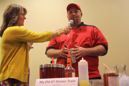 Josh Nally, who represented My Old Kentucky Dinner Train at Wednesday's Mixed Drink Challenge, fields questions about his mixed drink from Kim Huston, president of the Nelson County Economic Development Agency.