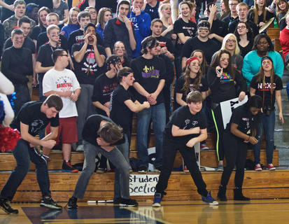 The Nelson County student section dances along to the band's tune during the girls' 5th Region championship.