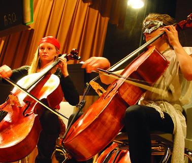 Lakin Festervan, left, and Sarah Carmine focus on their notes during Bardstown City Schools' string orchestra Halloween performance Thursday.