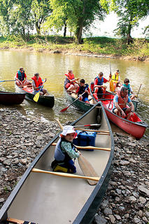 Hollis Hurst, 2, prepares for her first canoe trip as Boy Scout Troop 147 sets off on a 5.5-mile ride down the Beech Fork River to collect trash for the seventh annual Paddle Pickup, hosted by the Bardstown Boaters, May 21, 2011.