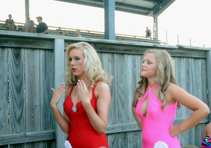 Kylie Ball, Bardstown, fans herself to keep cool moments before competing in the swimsuit competition in the Miss Nelson County Fair Pageant. Julia Mullins, Somerset stands nearby.