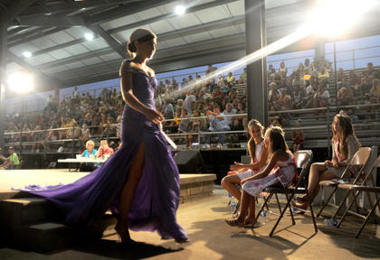 Alex Perkins, Hardin County, struts off the stage during the Miss Nelson County Fair Pageant. Perkins was crowned 2011 Miss Nelson County Fair.