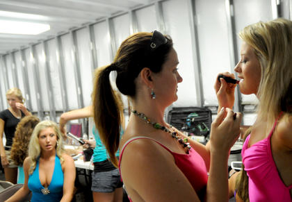 Crystal Cassity applies lipstick to Taylor McCleary, 18, Henry County moments before the swimsuit competition of the 2011 Miss Nelson County Pageant.