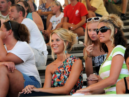 Kindra Clark, Julianna Wilkerson and Lisa Clark, Mount Washington, watch the pageant from the grandstand.