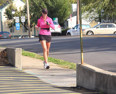 Caitlyn Kelly goes for a run on West Stephen Foster Avenue last Friday.