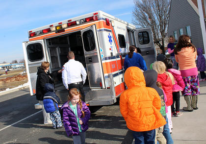 Nelson County EMS workers take kids to see the ambulance after reading to them as part of Dr. Seuss month at the Nelson County Early Learning Center.
