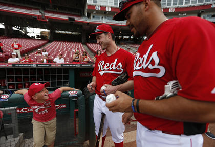 Parker Ellis, 6 son of slain Bardstown police officer Jason Ellis was all smiles as he got autographs from the Cincinnati Reds Jack Hannahan and Donald Lutz while he was a special guest for the Reds prior to their game against the Pittsburgh Pirates at Great American Ball Park. The Enquirer/Jeff Swinger