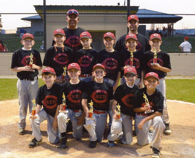 The Reds won the minor league championship at Dean Watts Park for the 9/10-year-old age group, finishing out the season with a 16-1 record. Team members include Mason Tucker, Sam Johnson, Scott Skaggs, Levi Greenwell, Andrew Berry, (middle) Wyatt Brown, Zachary Marks, Brad Greenwell, Cambron Stone, Jonathan Filiatreau, Lain Peake and (back) coaches Richie Berry and Travis Stone. 
