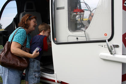 Michelle Hysell holds her grandson, Ray, 4, while they look inside a helicopter on display during the Safety Day Open House at the Bardstown Fire Department on N. 5th Street Saturday.