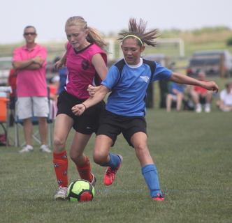 Laken Festervan of the U12 Nelson County Shockwave soccer team battles with a player from the Bruisers Soccer Club (Ashland) during a game at the Bluegrass State Games on July 20. The Shockwaves went on to win the game 4-0.