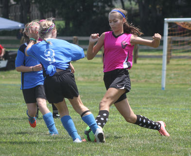 Lauren Lee of the U12 Nelson County Shockwave soccer team battles with players from the Bruisers Soccer Club (Ashland, KY) during a game at the Bluegrass State Games on July 20. The Shockwaves went on to win the game 4-0.