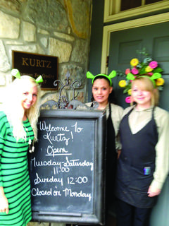 Employees at Kurtz got in character as Shrek for the show's opening July 6. Pictured are Jami Rogers, Jasmine Litsey and Emily Simpson.
