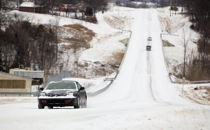 Boston Road remained covered in snow and ice at the western edge of Bardstown Monday morning, making travel treacherous for motorists.