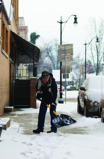 Stephen Hibbs clears snow form the sidewalk beside Crume Drug Store Monday morning as Nelson County dug itself out from under more than three inches of snow that fell overnight Sunday. The area has experienced about six inches more snowfall than average so far this year.