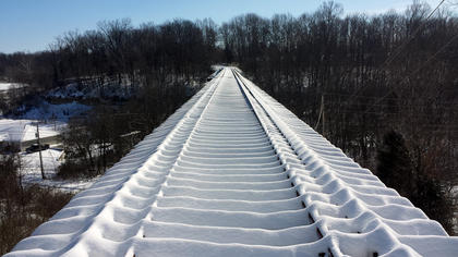 Snow coves the R.J. Corman railroad trestle above Old Bloomfield Pike Feb. 17.