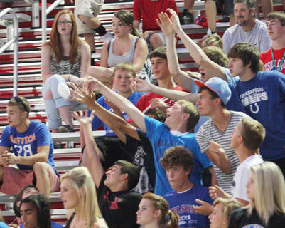 Nelson County students reach out for a souvenier from the cheerleaders in last Friday's game with Marion County.