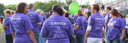 Cancer survivors line up just before 7 p.m. May 13 for the Survivors' Lap at the 2011 Relay for Life event, a fundraiser for the American Cancer Society, which provides support to those suffering from cancer and toward cancer research.