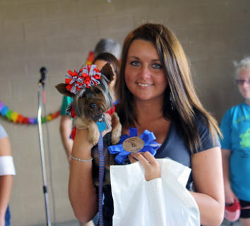 Taylor Milburn holds her dog, Pixie, after she won the Cutest Dog contest.