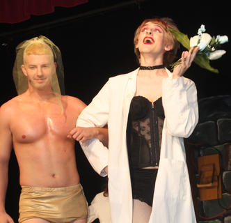 "Aaron High plays Rocky Horror and Adam Riley Dr. Frank 'N' Furter in the wedding scene from ""The Rocky Horror Show."""