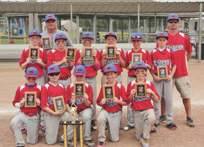 The Kentucky Thunder placed second in the 2012 Worth Baseball Challenge at Fort Knox in June. Team members include (front) Scott Skaggs, Levi Greenwell, Will Koger, Phillip Smith, Cody Doig, (middle) Trevor Reid, Lain Peake, Ryan Mattingly, Barrett McGill, Cambron Stone, Michael Nalley and (back) coaches Rick Smith and Travis Stone. Not pictured are team members Sam Johnson and Andrew Berry.