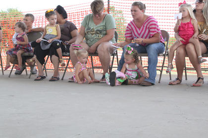 Contestants await the judges decision at the Nelson County Fair Tiny Tots Contest held Friday, July 20 at the Nelson County Fairgrounds.