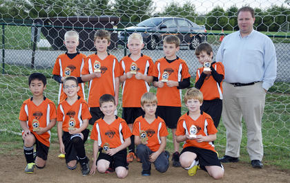 The U10 Scorpions won their division at Dean Watts Park this year. Team members include (front) Shusei Kondo, Seth Conway, Bill Evans, Gabriel Johnson, Brian Godbey, (back) Daniel Jackey, Hayden Wirth, Nathan Festervan, Chas Parrish, Caden Boren and coach John Evans. Not pictured is coach Craig Boren.