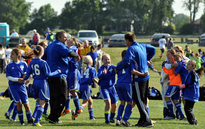 Players and coaches from the Smashers celebrate after winning the shootout to make it to the semifinals.