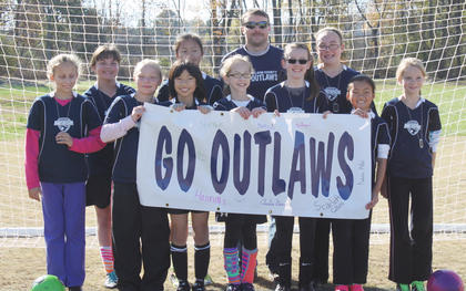 The Nelson County U12 Outlaws competed in the Commonwealth Cup at Elizabethtown Sports Park earlier this month. Team members include (front) Amelia Simerl, Abby Downs, Saki Soma, Scarlett Collins, Hannah Kennedy, Hannah Smith, Natalie Miller, (back) Madeline Hite, Brelayne Clutts, Coach Travis Downs and Shelby McClain.