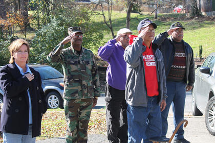 Members of the Abraham Lincoln Post 167 of the American Legion salute the flag during a Veterans Day ceremony this morning at Veterans Park. From left to right are Danielle Chladek, Earnest Brock, Kenneth Young, Mike Lydian and Joe Logan. Veterans will receive free admission to the Civil War Museum and other military museums on Broadway until 4 p.m. today.