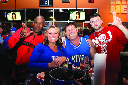 Friends (and basketball foes), from left, Don Burton, Dana and Jackie Walden, and Mike Watts at Buffalo Wings & Rings on game night.