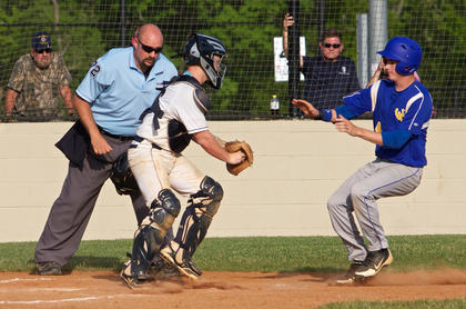 Thomas Nelson's Austin Nance puts the tag on a Washington County baserunner to prevent a run. The Commanders topped the Generals, 6-3, to advance in the 19th District tournament Monday.