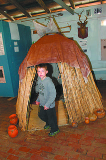 Jonny Knapp,  son of Brad and Elizabeth Knapp of Bardstown, visits an Indian wigwam.